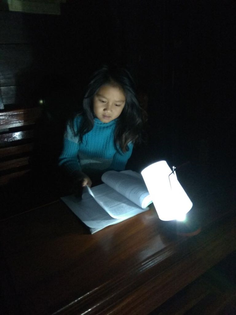 girl studying with solar lantern