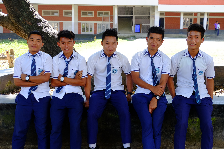 School Boys Sitting on Wall
